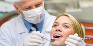 Dentist with patient for dental implant surgery