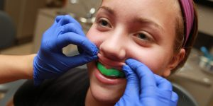 mouthguard for how sport effects your dental health