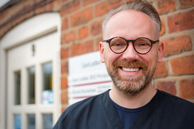 Photo of Dr Marcin Piekara outside Dental Solutions practice